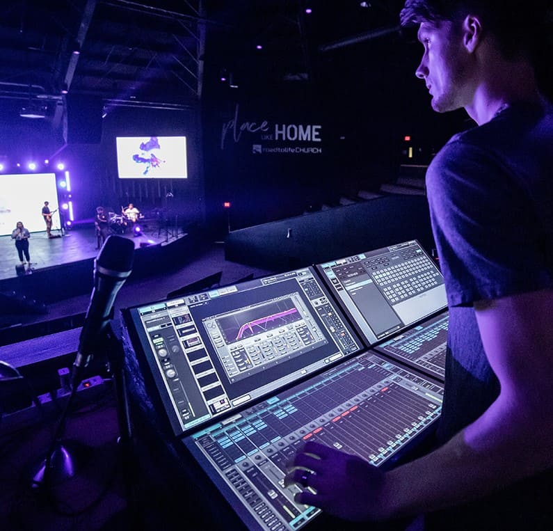 Technical Director Trevor Wright with the eMotion LV1 mixer at FOH