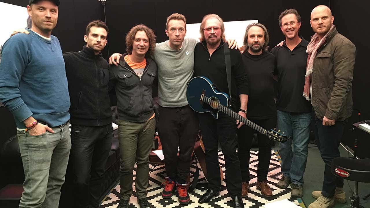 Gibb and Merchant with Coldplay backstage at Glastonbury Festival, June 2016