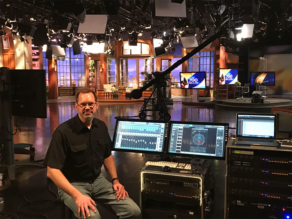Phil Peters and CBN's eMotion LV1 system on the set of The 700 Club